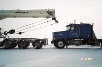 Push truck behind crane