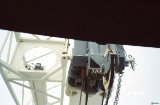 Crane boom close to push truck windshield