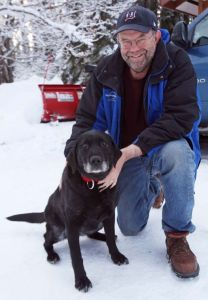 FAIRBANKS DAILY NEWS-MINER Blind Dog Survives Two Weeks In Cold Ed Davis poses with his dog Madera at his home Thursday morning, February 26, 2015. Madera, who is 11-years old and blind, survived two weeks in sub-zero temperatures after wandering away from home earlier this month.